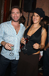 Artist TRACEY EMIN and MATT COLLISHAW at a party to celebrate the publication of Strangeland by artist Tracey Emin at 33 Portland Place, London W1 ON 21ST OCTOBER 2005.<br />