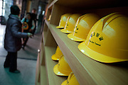 Dorasan/South Korea, Republic Korea, KOR, 28.11.2009: Helmets prepared for tourist tours to The 3rd Tunnel which was discovered on October 17, 1978. It is located 52km from Seoul. It was estimated that it took approximately an hour for 10,000 soldiers to move through the tunnel.