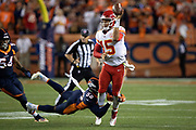 Kansas City Chiefs quarterback Patrick Mahomes (15) avoids a diving tackle attempt by Denver Broncos linebacker Von Miller (58) as he switches the ball from his right hand and throws a left handed shovel pass good for a gain of 6 yards to the Broncos 49 yard line on a third down play good for a first down during the NFL week 4 regular season football game against the Denver Broncos on Monday, Oct. 1, 2018 in Denver. The Chiefs won the game 27-23. (©Paul Anthony Spinelli)
