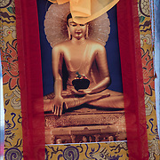 Asian work of art, a seated Buddha tapestry or wall hanging.