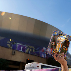 Feb 3, 2013; New Orleans, LA, USA; A vendor holds up a program before Super Bowl XLVII between the San Francisco 49ers and the Baltimore Ravens at the Mercedes-Benz Superdome. Mandatory Credit: Derick E. Hingle-USA TODAY Sports