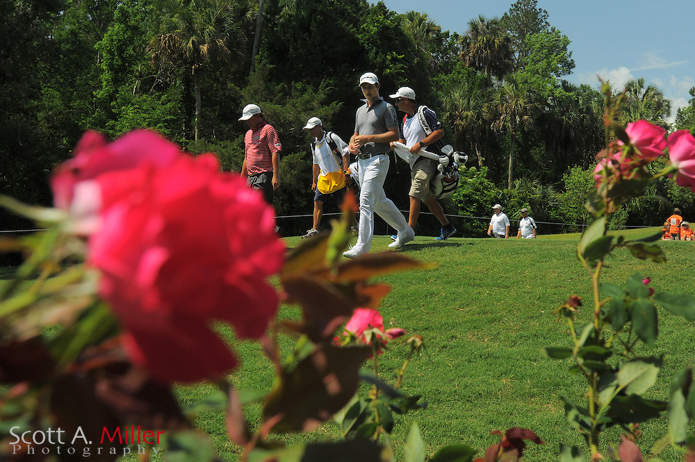 Justin Rose, in gray, and Jason Dufner walk off the eighth tee box during the third round of the Players Championship at the TPC Sawgrass on May 12, 2012 in Ponte Vedra, Fla. ..©2012 Scott A. Miller..
