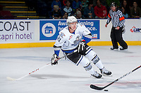 KELOWNA, CANADA - SEPTEMBER 28:  Austin Carroll #21 of the Victoria Royals skates on the ice after the puck at the Kelowna Rockets on September 28, 2013 at Prospera Place in Kelowna, British Columbia, Canada (Photo by Marissa Baecker/Shoot the Breeze) *** Local Caption ***