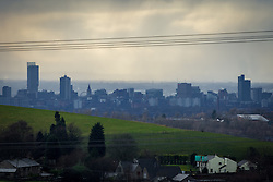 © Licensed to London News Pictures . 20/02/2014 . Manchester , UK . Landscape view across Manchester taken from Saddleworth near Oldham , featuring the city's iconic Beetham Tower on the left and the Piccadilly Tower Town Hall and Arndale Centre to its right . Photo credit : Joel Goodman/LNP
