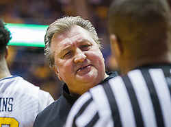 Feb 20, 2017; Morgantown, WV, USA; West Virginia Mountaineers head coach Bob Huggins talks to an official during the first half against the Texas Longhorns at WVU Coliseum. Mandatory Credit: Ben Queen-USA TODAY Sports