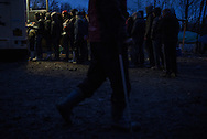 A line during a food distribution at the Dunkerque migrant camp, France. FEDERICO SCOPPA/CAPTA