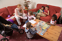 Children with Child minder in sitting room,