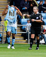 Photo: Richard Lane/Richard Lane Photography. Coventry City v Norwich City. Coca-Cola Championship. 09/08/2008. Coventry's Leon McKenzie is booked by referee, C Taylor after removing his shirt while celebrating  his goal.