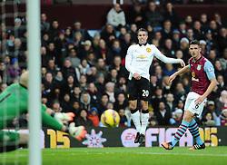 Manchester United's Robin van Persie volleys towards goal but his effort is saved by Aston Villa's Brad Guzan  - Photo mandatory by-line: Joe Meredith/JMP - Mobile: 07966 386802 - 20/12/2014 - SPORT - football - Birmingham - Villa Park - Aston Villa v Manchester United - Barclays Premier League