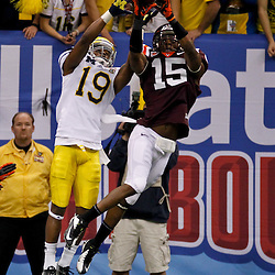 January 3, 2012; New Orleans, LA, USA; Virginia Tech Hokies defensive back Eddie Whitley (15) breaks up a pass intended for Michigan Wolverines wide receiver Kelvin Grady (19) during the second quarter of the Sugar Bowl at the Mercedes-Benz Superdome.  Mandatory Credit: Derick E. Hingle-US PRESSWIRE