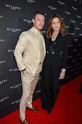 LUKE EVANS and CARLA SARKOZY at the launch of the new Bulgari flagship store at 168 New Bond Street, London on 14th April 2016.