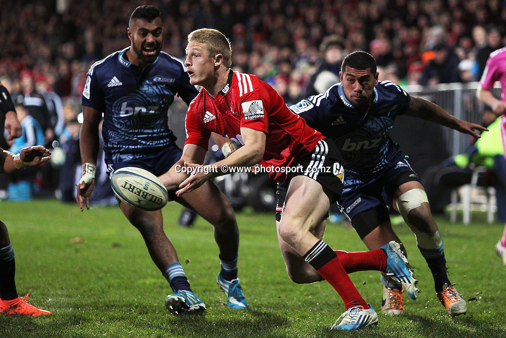 Johnny McNicholl of the Crusaders passes the ball on his own try line during the Investec Super Rugby game between Crusaders v Blues at AMI Stadium, Christchurch. 5 July 2014 Photo: Joseph Johnson/www.photosport.co.nz