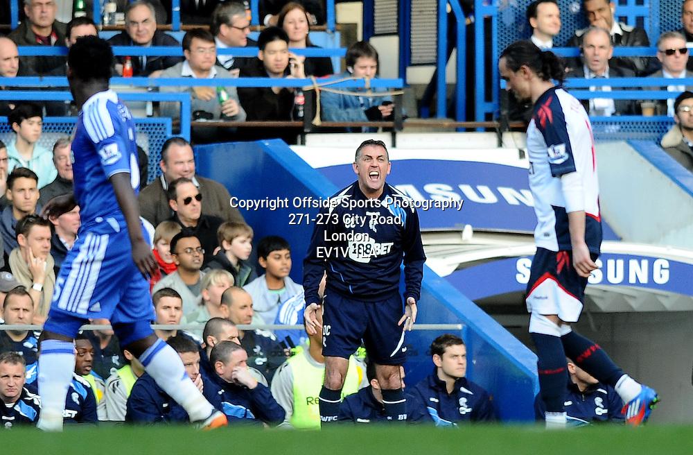 25/02/2012 - Barclays Premier League Football - 2011-2012 - Chelsea v Bolton Wanderers - Bolton manager Owen Coyle gets livid. - Photo: Charlie Crowhurst / Offside.