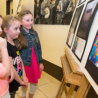 Sisters Abbie, Eimear and Orla Coll admiring the photography work from the CBS students in Glor on Thursday