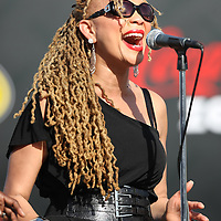 Backup singers of the Grammy award winning band Train sings during a one hour performance prior to the start of the NASCAR Coke Zero 400 race at Daytona International Speedway in Daytona Beach, Fl., on Saturday July 7, 2012. (AP Photo/Alex Menendez) Grammy Award winning band TRAIN plays an hour long concert prior to the NASCAR Coke Zero 400 race at Daytona International Speedway in Daytona Beach, Florida on July 7, 2012.