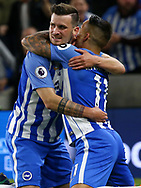 Pascal Gross of Brighton celebrates scoring the opening goal with Anthony Knockaert during the Premier League match between Brighton and Hove Albion and Manchester United at the American Express Community Stadium in Brighton and Hove. 04 May 2018