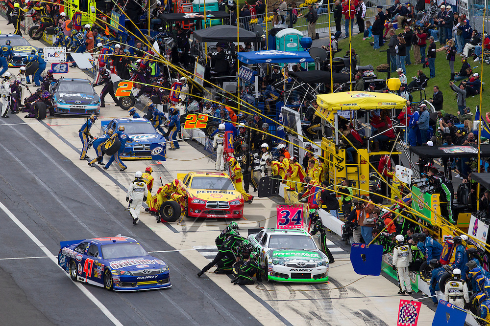 DOVER, DE - OCT 02, 2011:  Kyle Busch (18), Kurt Busch (22), and Denny Hamlin (11) come in for pit stops during the AAA 400 race at the Dover International Speedway in Dover, DE.