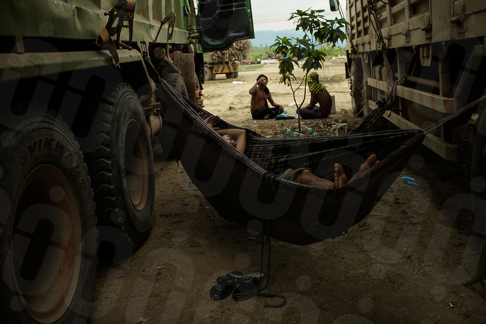 "Truck drivers rest inside the ""Phnom Penh Sugar Ltd"" factory's ground. Omlaing commune, Kompong Speu Province - Cambodia. 29 Mar. 2013 © Thomas Cristofoletti / Ruom"