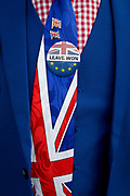 As MPs decide on how to progress with Brexit parliamentary procedure, a Leaver Brexiteer's Union Jack tie and badge outside the UK Parliament in Westminster, on 28th March 2019, in London, England