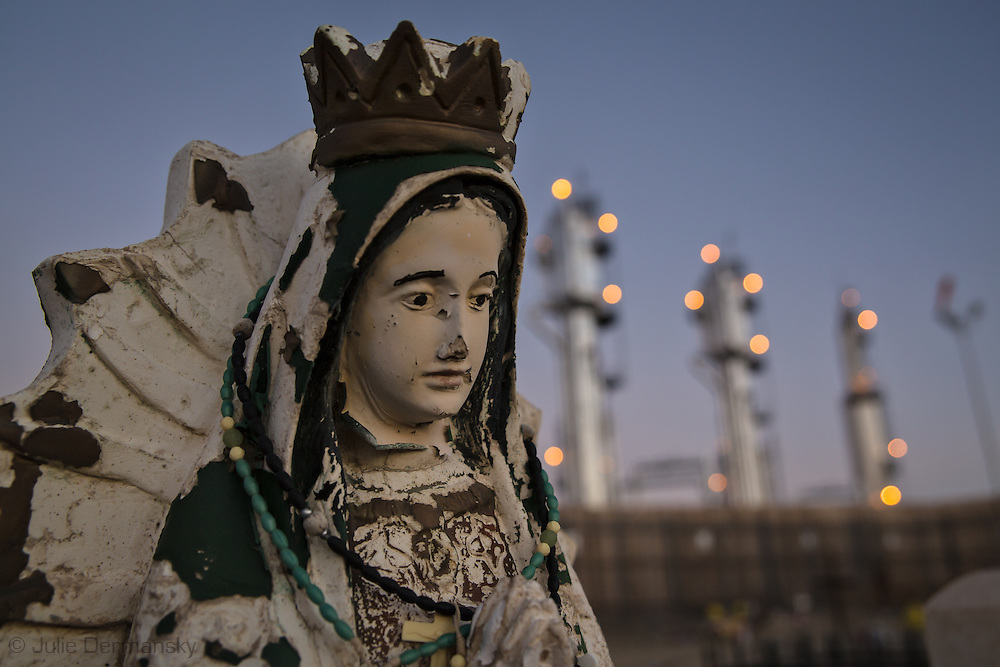 Virgin de Guadalupe statue in the St. Mary's Cemetery in Bloomfield, NM, next to a Conoco-Phillips San Juan Gas Plant. Bloomfield is in the northwestern part in New Mexico in the San Juan Basin where the fracking industry is booming.