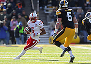 November 23 2012: Nebraska Cornhuskers running back Braylon Heard (5) eyes Iowa Hawkeyes defensive back Tanner Miller (5) on a run during the first half of the NCAA football game between the Nebraska Cornhuskers and the Iowa Hawkeyes at Kinnick Stadium in Iowa City, Iowa on Friday November 23, 2012. Nebraska defeated Iowa 13-7 in the Heroes Game on Black Friday.