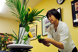 "Yumiko Aso from Aptos teaches ""ikebana"" flower-arranging skills to attendees of a class at the 2012 Obon Festival at the Buddhist Temple of Salinas."