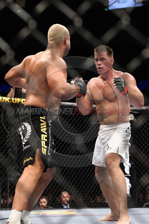 "LONDON, ENGLAND, JUNE 7, 2008: Antoni Hardonk (facing) battles Eddie Sanchez during ""UFC 85: Bedlam"" inside the O2 Arena in Greenwich, London on June 7, 2008."