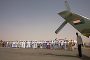 Beneath the tail rotor of a Sudan army helecopter gunship, digitaries, officials and tribal elders line-up to greet the British peer, Lord Ahmed who has arrived with a delegation in this war-torn province of Sudan to attend the first-ever international Conference on Womens' Challenge in Darfur, hosted by the govenor in his own compound. Nazir, Baron Ahmed (born 1958) is a member of the House of Lords, having become the United Kingdom's first Muslim life peer in 1998.