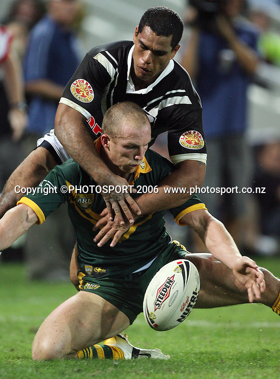 Kiwis wing Jake Webster comes over the top of Darren Lockyer during the Rugby League test match between the New Zealand Kiwis and the Australian Kangaroos at Suncorp Stadium, Brisbane, Australia on Friday 5 May, 2006. Australia won the match 50 - 12. Photo: Hannah Johnston/PHOTOSPORT<br /><br /><br /><br />050506