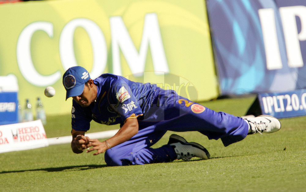 PORT ELIZABETH, SOUTH AFRICA - 02 May 2009. Abhishek Raut mis-fields and four runs are scored during the  IPL Season 2 match between the Deccan Chargers and the Rajatshan Royals held at St Georges Park in Port Elizabeth , South Africa..