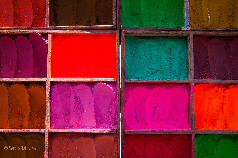 Trays of multi-colored dyes in powder form are sold at the entrance to the Pashupatinath temple near Kathmandu, Nepal.