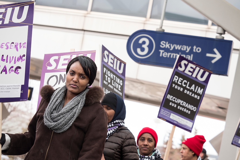 Lydia Meshesha walks with Twin Cities janitors represented by Service Employees International Union during a picket for a wage increase at Minneapolis-St. Paul International Airport's Terminal 1 February 17, 2016.  The union is asking for $15 for both full and part-time workers.