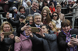 March 30, 2019 - Kiev, Ukraine - Ukraine's President Petro Poroshenko seen posing for a photo with Ukrainians after prayers for fair elections..Presidential elections in Ukraine will be held on March 31, 2019. (Credit Image: © Sergei Chuzavkov/SOPA Images via ZUMA Wire)