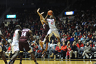 "Mississippi Rebels guard Stefan Moody (42) is fouled by Texas A&M Aggies guard Jordan Green (5) at the C.M. ""Tad"" Smith Coliseum in Oxford, Miss. on Wednesday, February 4, 2015. (AP Photo/Oxford Eagle, Bruce Newman)"