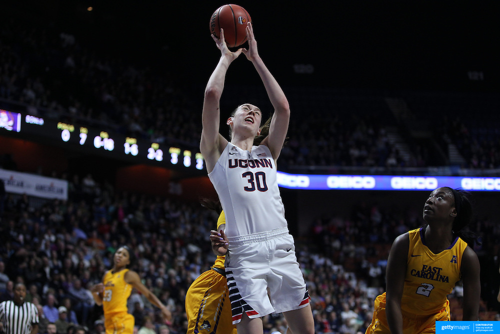 Breanna Stewart, UConn, drives to the basket challenged by L'Tiana Taylor, (left) and Khadidja Toure, East Carolina,  during the UConn Huskies Vs East Carolina Pirates Quarter Final match at the  2016 American Athletic Conference Championships. Mohegan Sun Arena, Uncasville, Connecticut, USA. 5th March 2016. Photo Tim Clayton