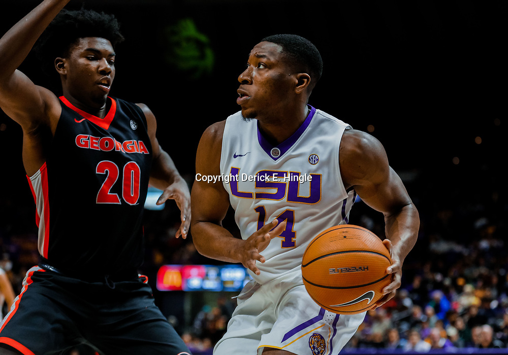 Jan 16, 2018; Baton Rouge, LA, USA; LSU Tigers guard Randy Onwuasor (14) is defended by Georgia Bulldogs forward Rayshaun Hammonds (20) during the second half at the Pete Maravich Assembly Center. Georgia defeated LSU 61-60. Mandatory Credit: Derick E. Hingle-USA TODAY Sports