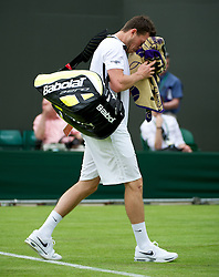 LONDON, ENGLAND - Monday, June 25, 2012: Josh Goodall (GBR) walks off dejected after losing during the Gentleman's Singles 1st Round on the opening day of the Wimbledon Lawn Tennis Championships at the All England Lawn Tennis and Croquet Club. (Pic by David Rawcliffe/Propaganda)