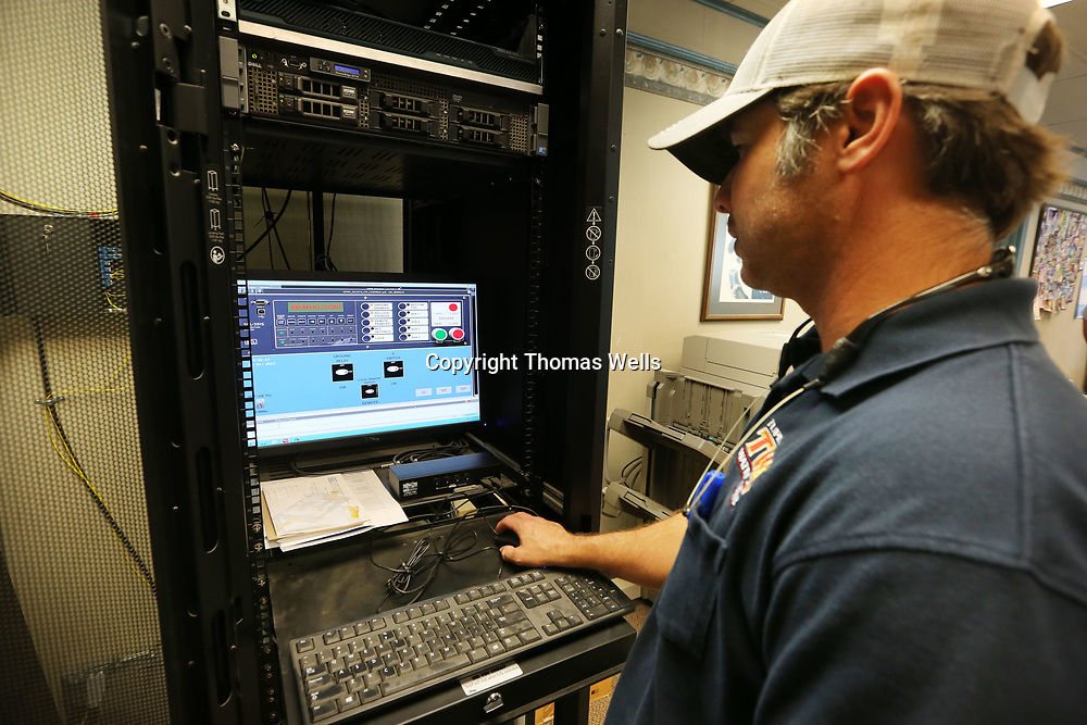 Tupelo Water & Light's Norman Cruse monitors the cities power substations at the headquarters on Front Street by using a fiber optic network that the city has built.