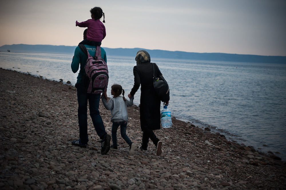 How far is to walk to Sweden ? <br /> A Syrian family that just landed in the Greek island of Lesvos walks towards the nearest police station to report their arrival and get registered. Near Skala Sikamineas, Lesvos , Greece