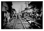 Rail line cuts through squatters makeshift houses in Tondo Slum, Manila, Philippines.  The intensity of poverty which has eased in Southeast Asian countries like Malaysia and Thailand, had shown no signs of easing in the Philippines.