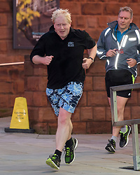 © Licensed to London News Pictures. FILE PICTURE: 03/10/2017. Manchester, UK. British foreign secretary BORIS JOHNSON seen running ahead of his speech on day three of the Conservative Party Conference. The PM was pictured today wearing the same shorts as he returned to jogging for the first time since contracting COVID-19. Photo credit: Ben Cawthra/LNP