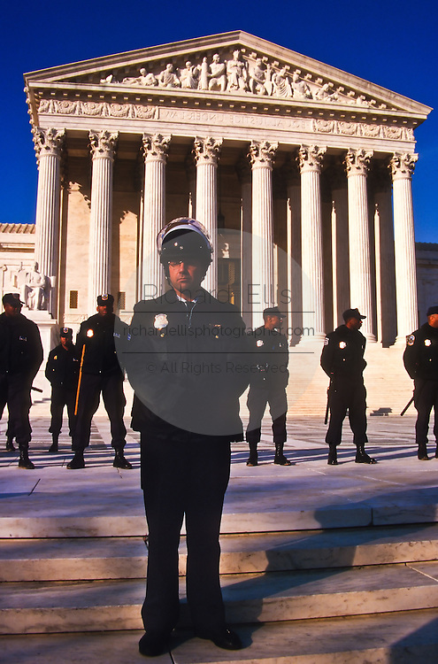 Riot police guard the US Supreme Court during a protest in Washington, DC