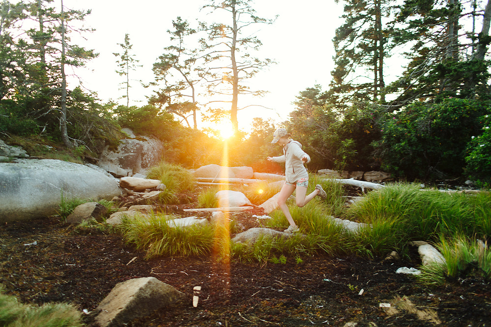 Woman Balancing on Rock, outdoors.