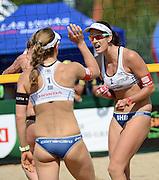 STARE JABLONKI POLAND - July 3: Nadine Zumkehr /1/ and Joanna Heidrich /2/ of Switzerland in action during Day 3 of the FIVB Beach Volleyball World Championships on July 3, 2013 in Stare Jablonki Poland.  (Photo by Piotr Hawalej)