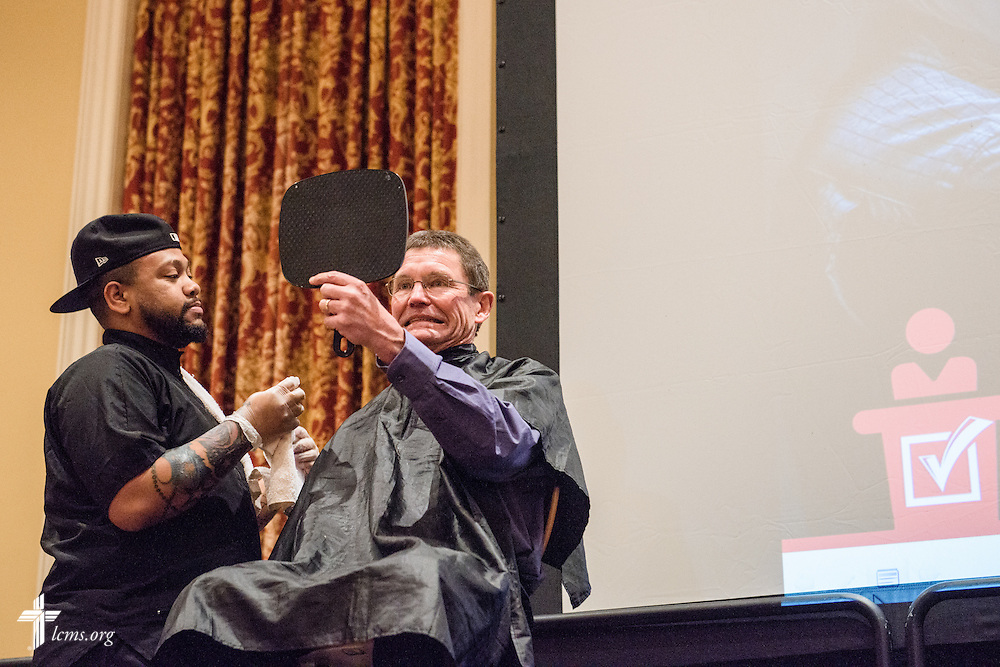 """The Rev. Terry R. Forke, president of Montana District, reacts to his shaved mustache during """"the Great Mustache Shave Off"""" at the Liberty National LCMS Campus Ministry Conference on Wednesday, Jan. 4, 2017, at the University of Maryland in College Park, Md. LCMS Communications/Erik M. Lunsford"""