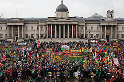 Occupy Wonga May Day. Protesters gather holding National Union and Socialist banners at Trafalgar Square on the annual May Day march. Central London, United Kingdom. Thursday, 1st May 2014. Picture by Daniel Leal-Olivas / i-Images