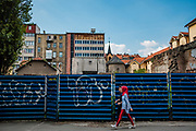A young muslim girl and her friend walk near a graffitied wall in downtown Sarajevo. The city continues to be a diverse mix of religions and ethnicities inspite of it's troubled past.