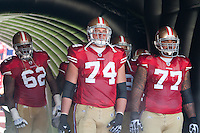 18 September 2011:  Offensive linemen (62) Chilo Rashal, (74) Joe Staley, and (77) Mike Iupati of the San Francisco 49ers stand in the tunnel before his name is called during player introductions before the Cowboys 27-24 overtime victory against the 49ers in an NFL football game at Candlestick Park in San Francisco, CA