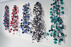 Jewelry necklaces on white wall