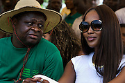 "An African member of the Abuja Green Society  is joined by super model Naomi Campbell at a tree planting ceremony in association with the 3rd annual ThisDay Festival July 11, 2008 in Abuja, Nigeria. The festival, themed ""Africa Rising"" is intended to raise awareness of African issues while promoting positive images of Africa while highlighting the continent's music, culture and fashion.This year's Festival includes concerts and events not only in Nigeria, but also in Washington D.C. and London."